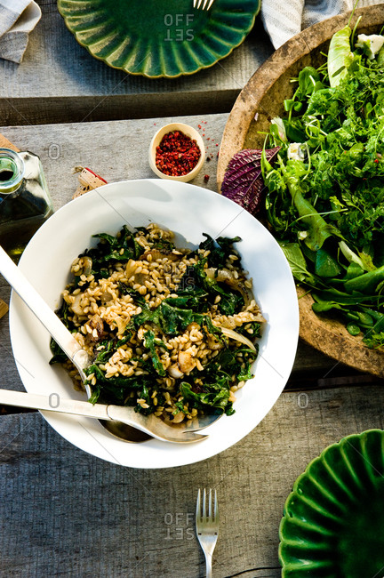 Wheat berries with kale served on a table