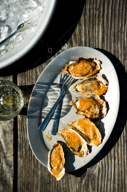 Oysters with creamy sauce on a platter