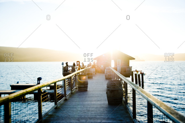 Dock house on a pier at sunset