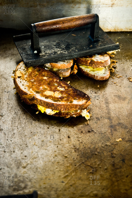 Grilled cheese sandwiches on a griddle stove