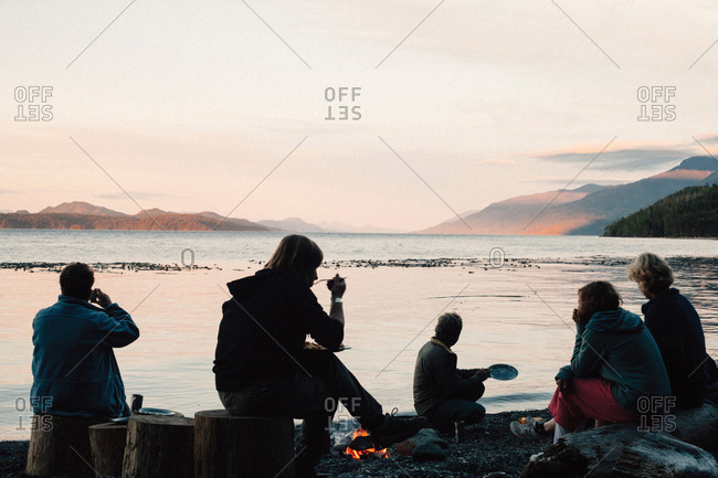 People watching the sunset and having a dinner on beach
