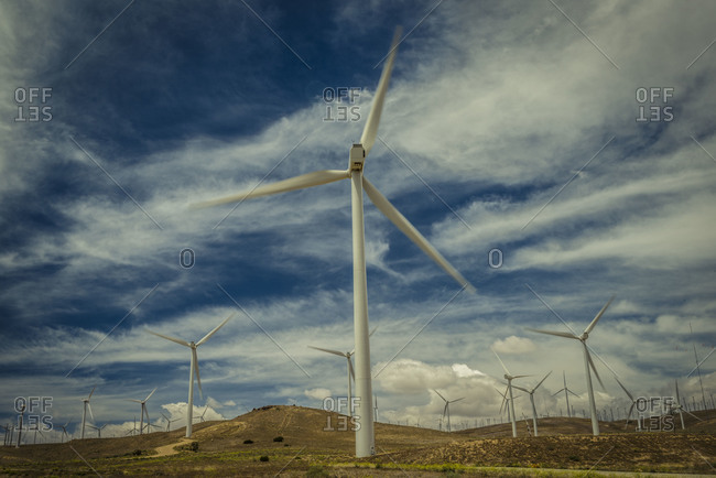 Wind farm under a cloudy sky in Tehachapi Pass, California