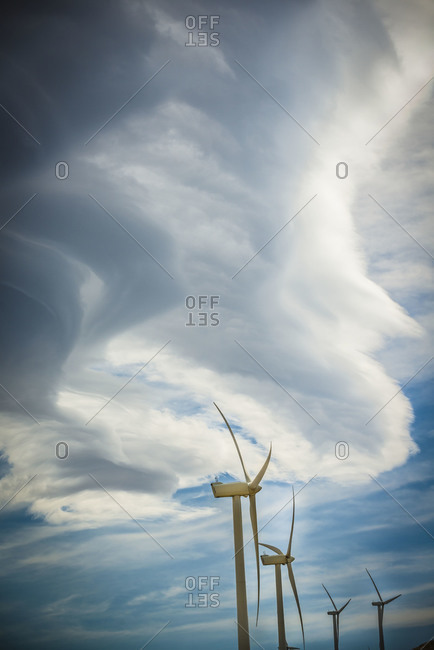 Wind turbines against a cloudy sky in Tehachapi Pass, California