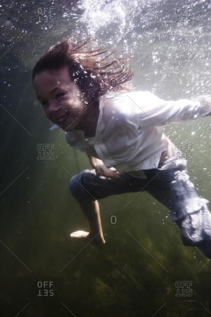 Redhead boy having fun in the sea