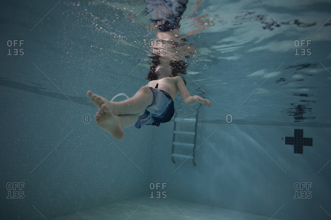 Boy floating on his back in a swimming pool