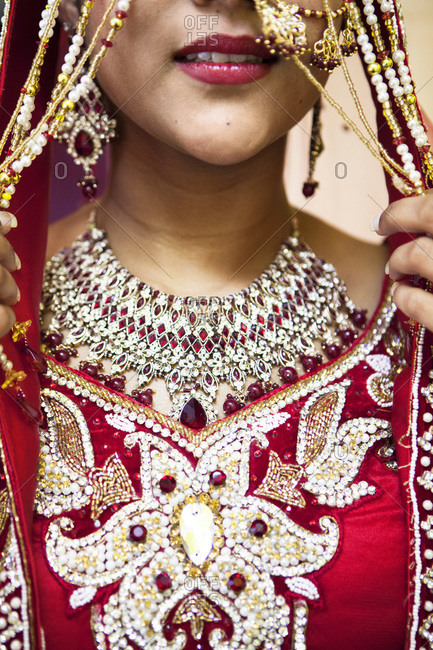 Close-up of Hindu woman getting ready for wedding, Toronto, Ontario, Canada