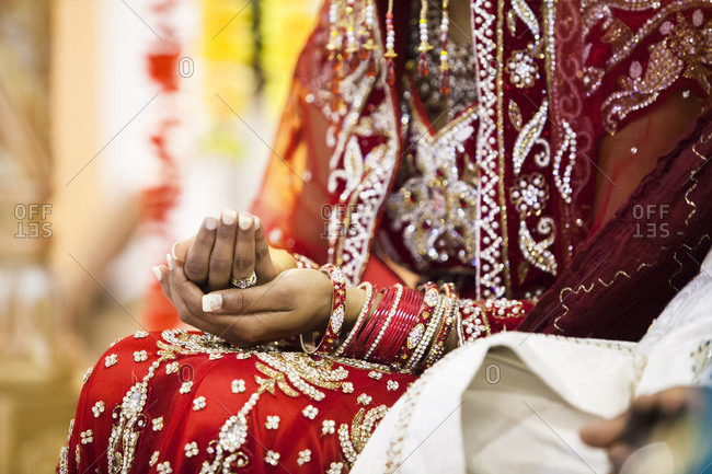Close-up of woman's hands during Hindu wedding ceremony, Toronto, Ontario, Canada