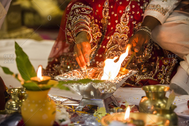 Bride and groom performing fire ritual at Hindu wedding ceremony, Toronto, Ontario, Canada