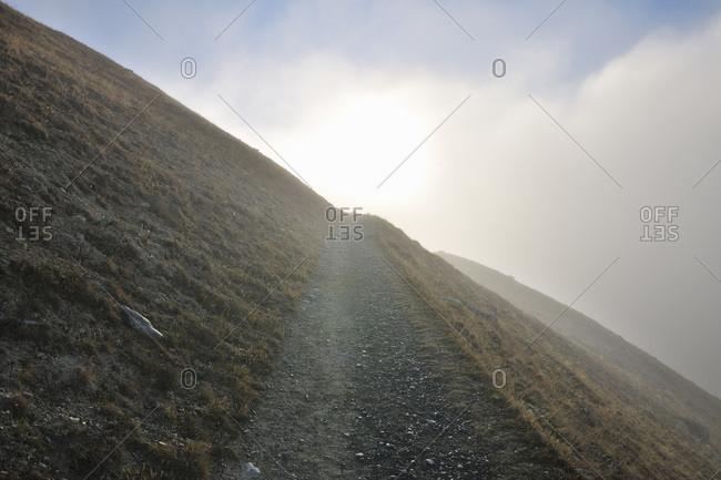 Mountain path in fog, Findeln, Zermatt, Alps, Valais, Switzerland