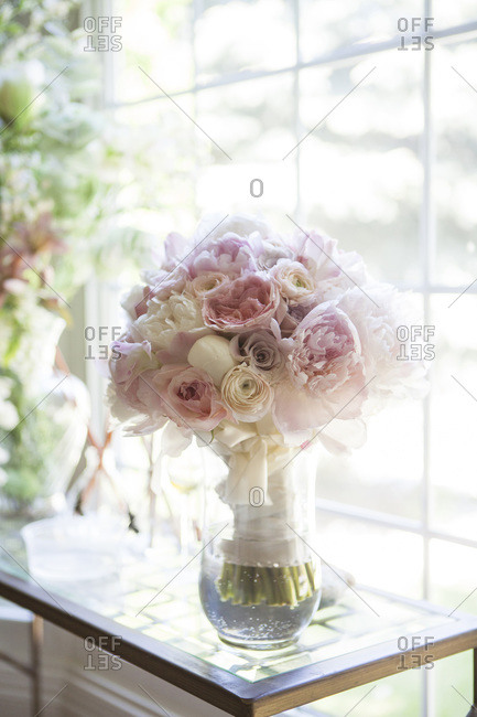 Bouquet of flowers in vase by window, Toronto, Ontario, Canada