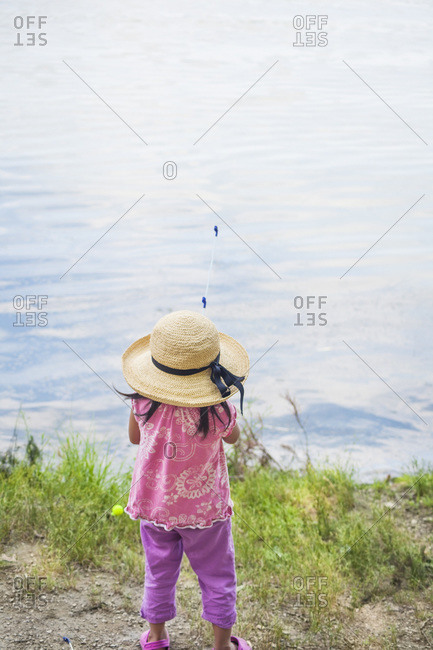 Back view of girl in sun hat fishing, Lake Fairfax, Reston, Virginia, USA