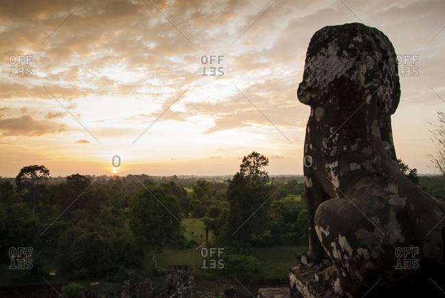 Angkor Wat, Cambodia - October 24, 2009:A lion sculpture facing the setting sun