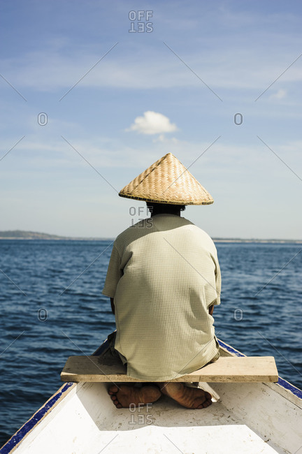 Man sitting in the bow of a boat on the way from Lombok to Gili Islands, Indonesia