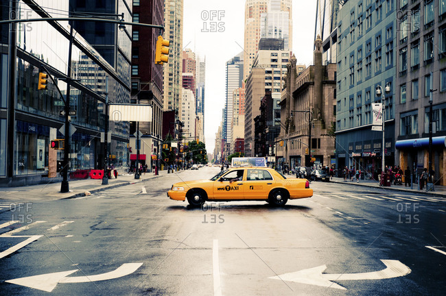 New York City - August 28, 2011: Yellow cab crossing the road