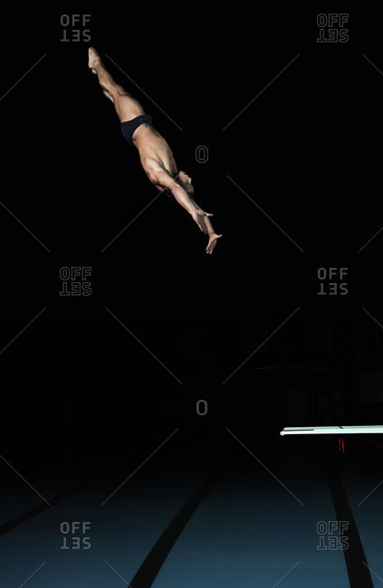 November 22, 2011: Side view of a man diving from a springboard