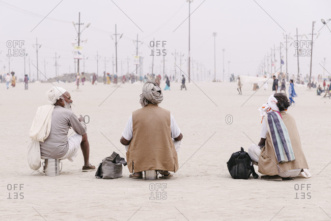 Kumbh Mela, India - February 5, 2013: Elderly men having conversation
