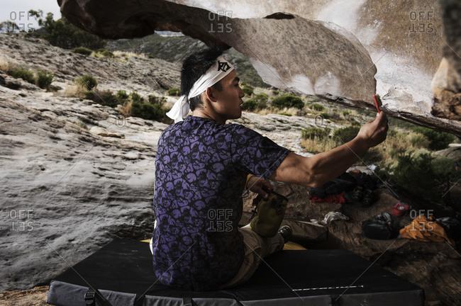Melbourne, Australia - December 19, 2010: Asian man brushing a rock
