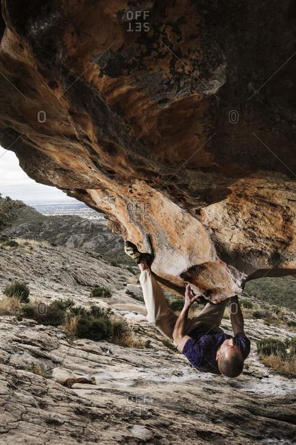 Melbourne, Australia - December 19, 2010: Man climbing a rock