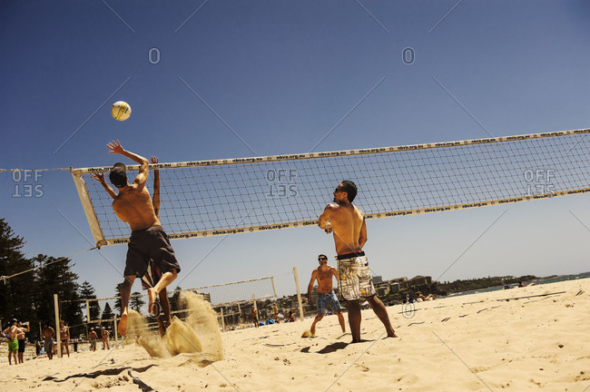 Sydney, Australia - December 29, 2010: Young men playing beach volleyball
