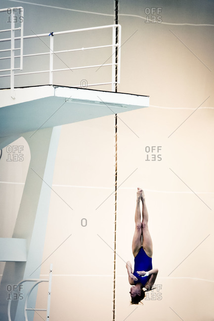February 24, 2011: Woman jumping off from a diving platform
