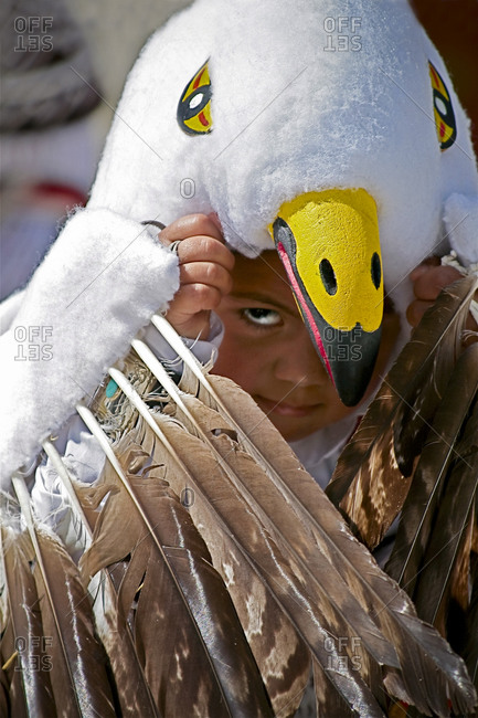 Ohkay Owingeh Pueblo, New Mexico, USA - May 15, 2008: Little girl with Native American eagle headdress
