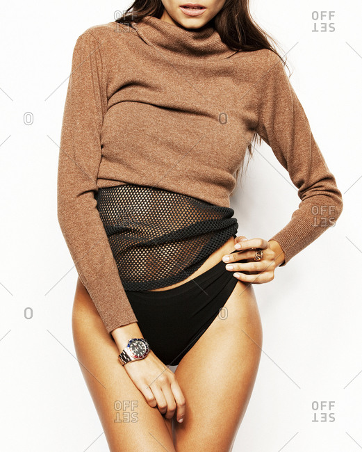 Studio shot of a brunette woman posing in panties and pullover