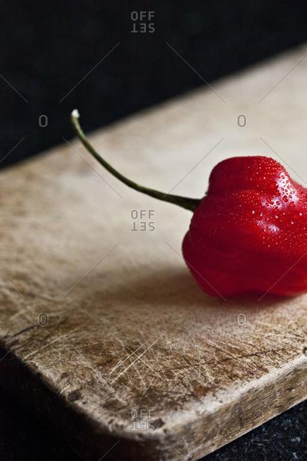 Habanero pepper on chopping board