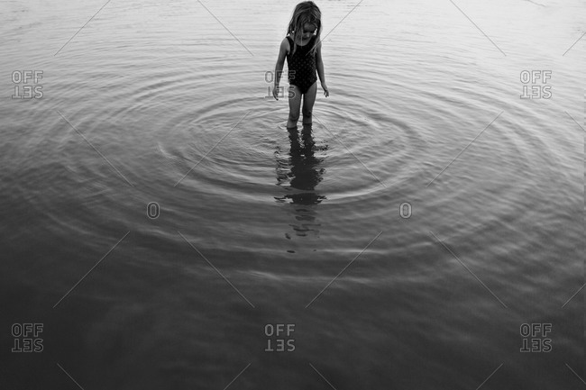 Little girl standing in shallow water