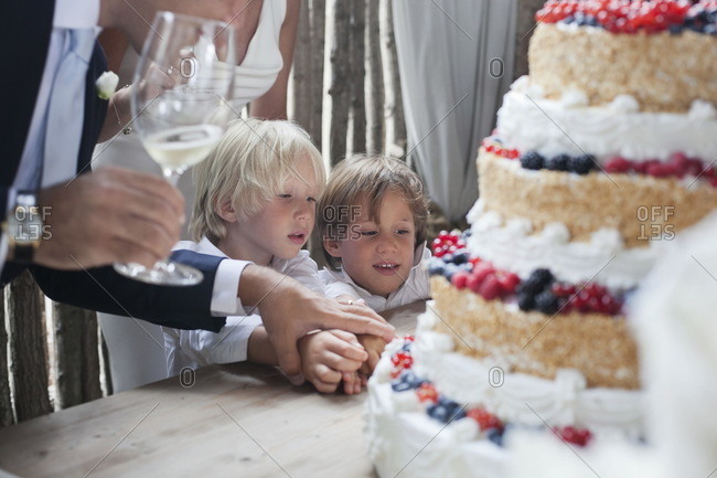 Telese, Campania, Italy - September 15, 2012: Children looking at a wedding cake