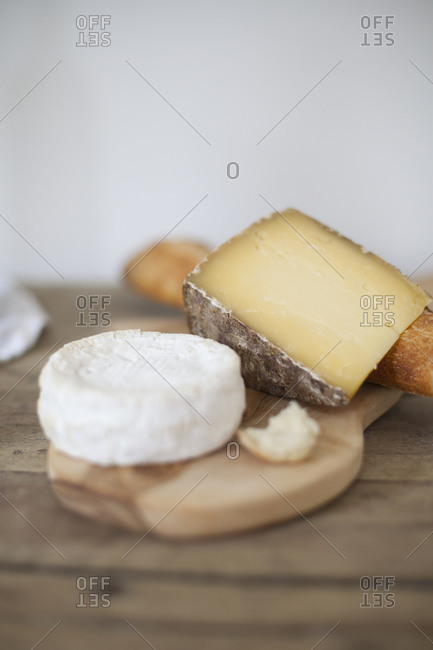 Still life of two types of cheese with a baguette
