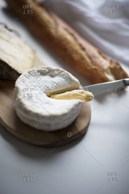 Still life of baguette and camembert