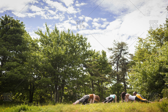 Yoga class in  nature - Offset