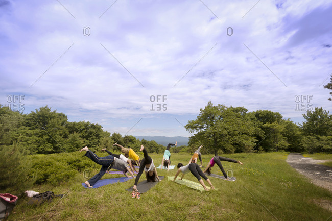 People in yoga class outdoors