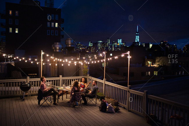 Young people having a rooftop party, Brooklyn