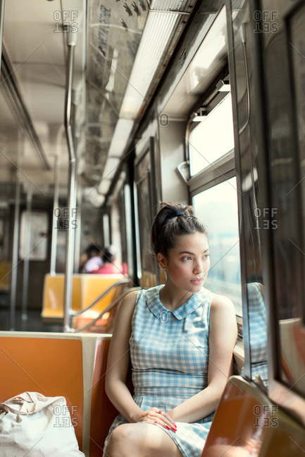 Young woman on subway car