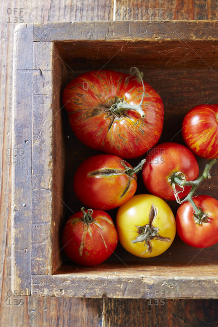 Heirloom tomatoes in a wooden box