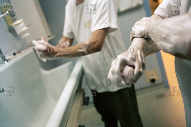 Surgeons washing their hand with surgical soap