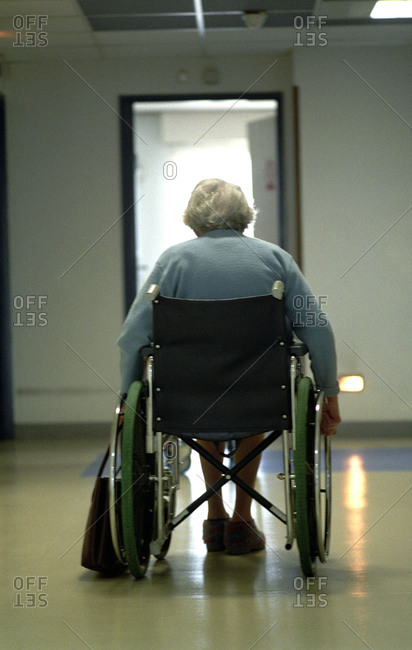 Rare view of an elderly lady in a wheelchair at a nursing home.
