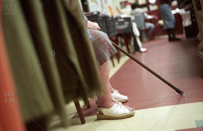 Low section of an elderly lady sitting in a nursing home.