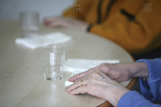 Close up of an elderly patient hands in a nursing home