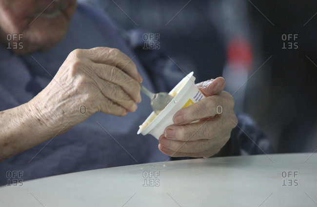 Close up of an elderly patient eating  in a nursing home