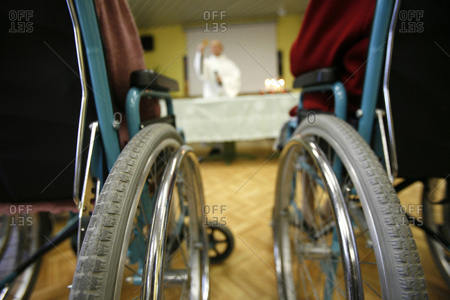 Close up of wheelchairs in a retirement home.