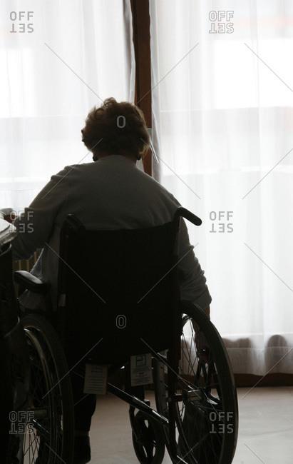 Woman in wheelchair in a retirement home.