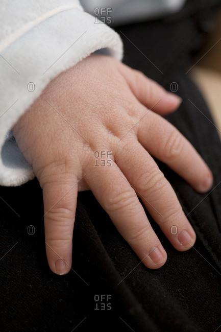 Hand of a newborn baby boy.
