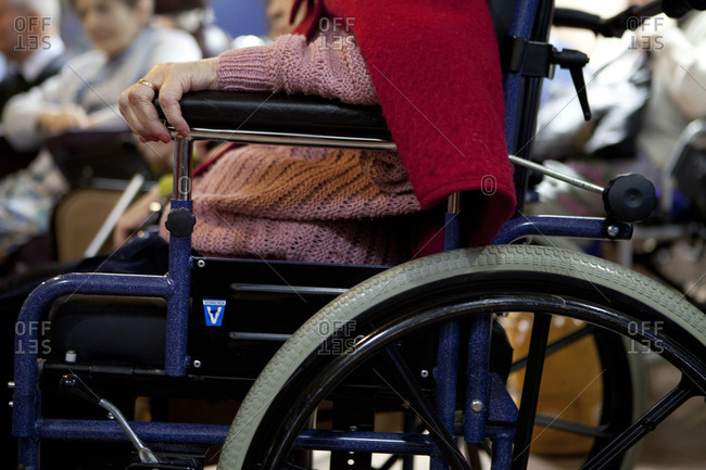Close up of an elderly woman sitting in a wheelchair