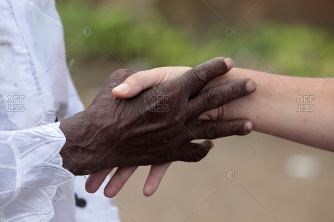 Close up view of two people handshaking