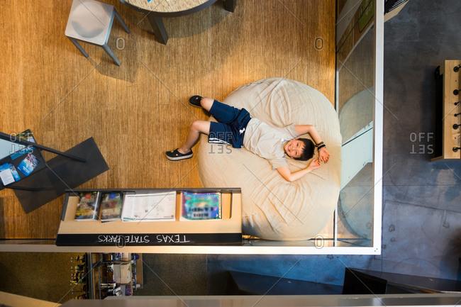 Boy resting on a bean bag in a Recreational Center