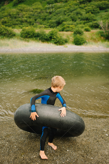 Boy playing with an inner tube