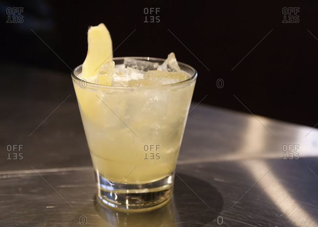 Close up of a glass of ginger cocktail