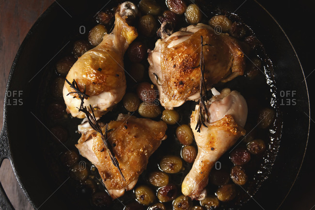 Roasted chicken thighs in a skillet